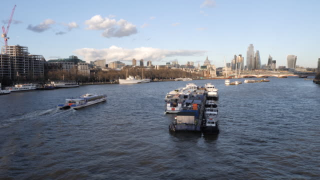 london cityscape from waterloo bridge and anchored ferries on the thames river - moored stock videos & royalty-free footage