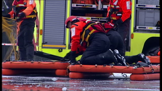london clapham firefighters training exercise simulating someone trapped and drowning after falling through ice david o'neill interview sot * * david... - moving after stock videos & royalty-free footage