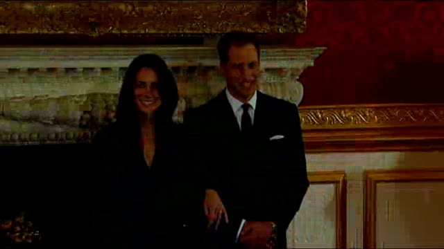 london clarence house int prince william and his fiancee kate middleton enter room and stand together for press photocall flashlights from press... - duchess of cambridge stock videos & royalty-free footage