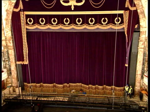 london coliseum in scaffolding tilt up to ball on roof nick thompson interview sot cs gold decorating with caesar pompey on it cs gold leaf at top of... - gold leaf stock videos & royalty-free footage