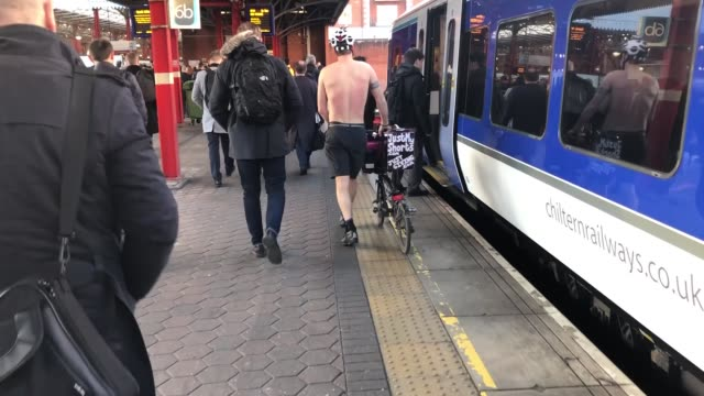 london commuter cycles shirtless to raise money for charity england london various of graham hardman on train ext various of graham hardman on... - shirtless stock videos & royalty-free footage