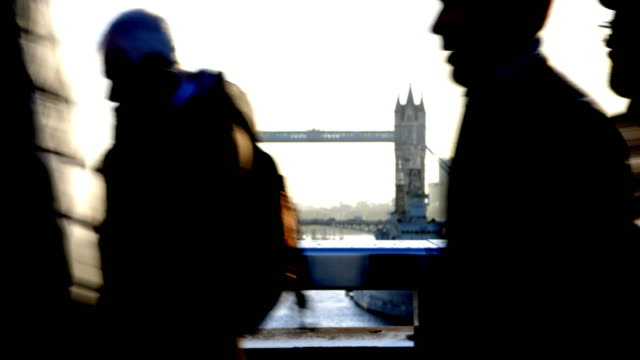 London commuters. Silhouette with Tower Bridge as a backdrop.