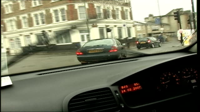 london congestion charge zone extension: exemptions for greener hybrid cars; int car driver's point of view traffic along on road track forwards... - alternative fuel vehicle stock videos & royalty-free footage