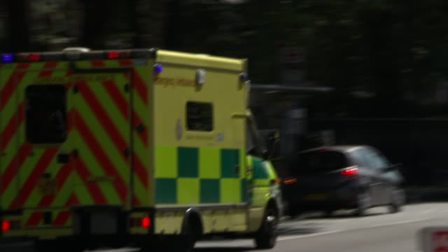 London council leaders refuse to sign off cuts to NHS services London Ambulance along as siren heard SOT Vox pops
