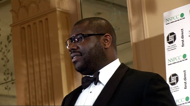 stockvideo's en b-roll-footage met london critics' circle film awards 2009 celebrity interviews winner's room steve mcqueen posing with british newcomer of the year award / steve... - criticus