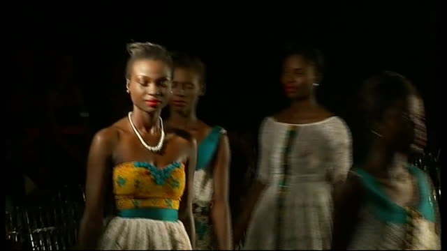 london designers take part in lagos fashion show; nigeria: lagos: int various of models along catwalk at fashion show crowded models' dressing room,... - itv london tonight weekend stock-videos und b-roll-filmmaterial