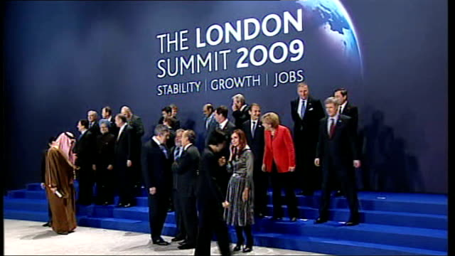 london docklands excel centre world leaders gathering for group photocall at g20 summit gordon brown speaking into microphone at place next to... - g20 leaders' summit stock videos & royalty-free footage