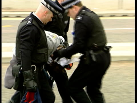 london docklands ext protesters shouting at police officers as surrounded by press photographers track sot protesters sitting on road to form... - london docklands stock videos & royalty-free footage