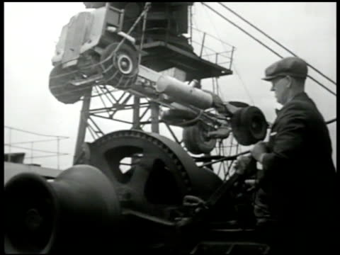 stockvideo's en b-roll-footage met london docks ships harbor. crane lifting chassis of truck english worker. man giving signal hang gestures. workers pushing truck onto loading net.... - chassis