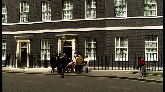 downing street: ext dame joan bakewell along with others to number 10, to protest against cuts to the number of sheltered housing wardens - joan bakewell stock videos & royalty-free footage