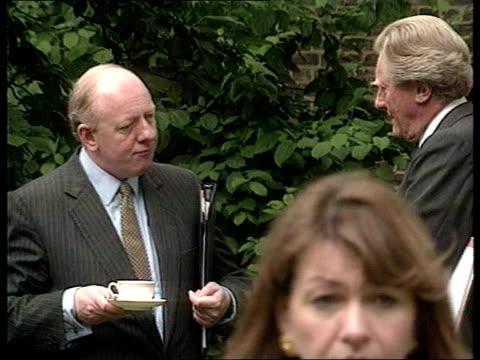 London Downing Street SLOMO Alistair Goodlad chatting to Michael Heseltine MP at Downing Street garden party Goodlad chatting to John Major MS...