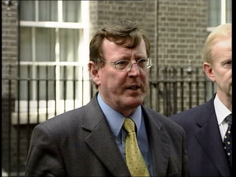 london downing street ext ulster unionist leader david trimble mp and other members of his party along pan to mikes david trimble mp speaking to... - politics and government stock videos & royalty-free footage