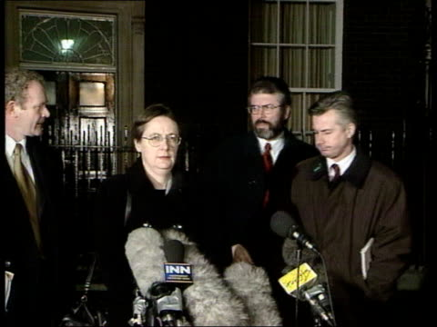 london downing street ms sinn fein delegation including martin mcguinness and gerry adams out of no10 and up to press conference mics ms door of no10... - wastepaper bin stock videos & royalty-free footage