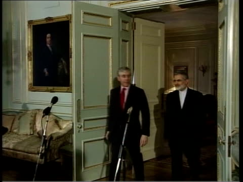 london downing street int foreign secretary jack straw mp into room with visiting iranian foreign minister kamal kharrazi press straw speaking clean... - jack straw stock videos and b-roll footage