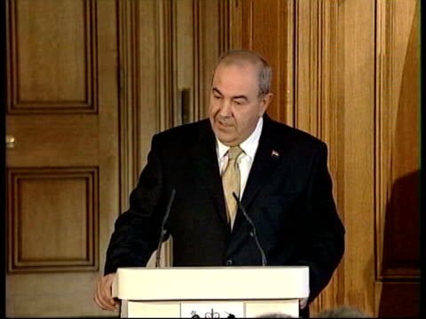 London Downing Street INT Iyad Allawi speaking at podium EXT Allawi and Blair shaking hands and Allawi walking away
