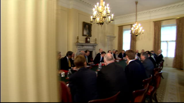 stockvideo's en b-roll-footage met london downing street number 10 int general view cabinet ministers around table for first cabinet meeting of conservativeliberal democrat coalition... - prime minister
