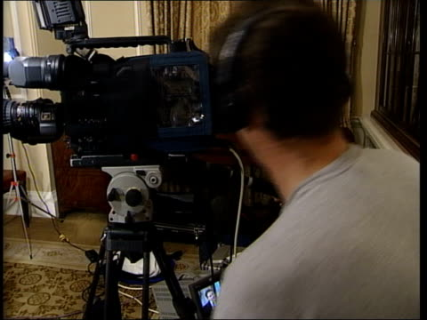 Downing Street Tony Blair MP sitting for television interview with Al Jazeera TV SIDE Cameraman SIDE Blair interviewer as Blair speaks SOT Can't...