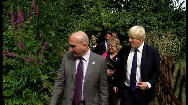 london: dulwich: ext boris johnson visiting a london wildlife trust project and making joke about falling in the river in june 2009 sot - i won't get... - dulwich stock videos & royalty-free footage