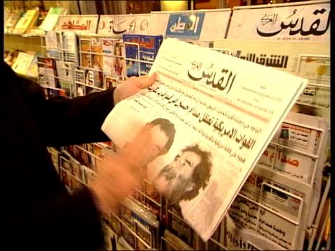 london edgware road muslim men sitting in cafe 2shot jihad alkhazen discussing arabic newspaper headline on saddam hussein as holding paper sot cs... - jihad stock videos & royalty-free footage