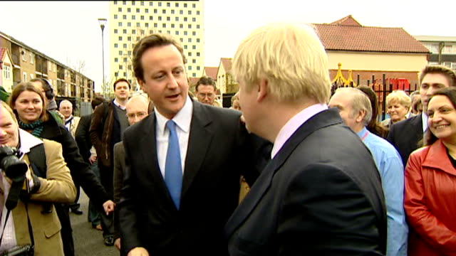 edmonton slow motion johnson and david cameron mp on walkabout as punch fists together - デビッド・キャメロン点の映像素材/bロール