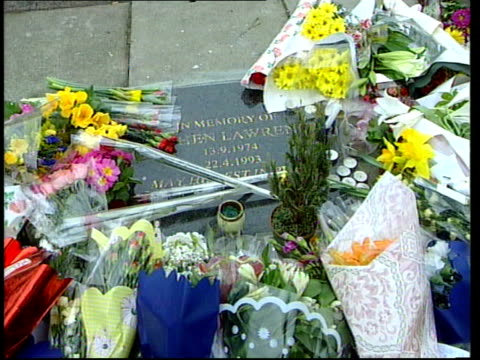london eltham flowers laid at memorial plaque at site of murder of stephen lawrence man leaving flowers cs card on flowers - memorial plaque stock videos and b-roll footage