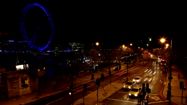 London, Embankment and Big Ben at night. Time lapse.