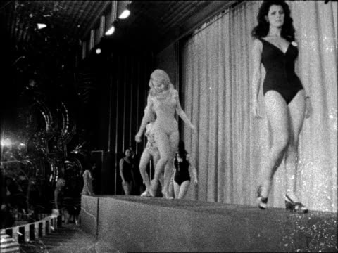 empire ballroom ms pan girls seated cs brunette combs hair ms side three girls stand ms blonde poses cs black lady walks off another entrant posing... - beauty contest stock videos & royalty-free footage