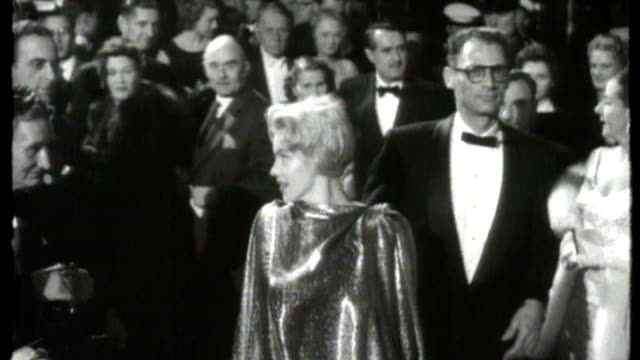 empire leicester square marilyn monroe along with husband arthur miller and posing for cameras - 1956 stock videos and b-roll footage