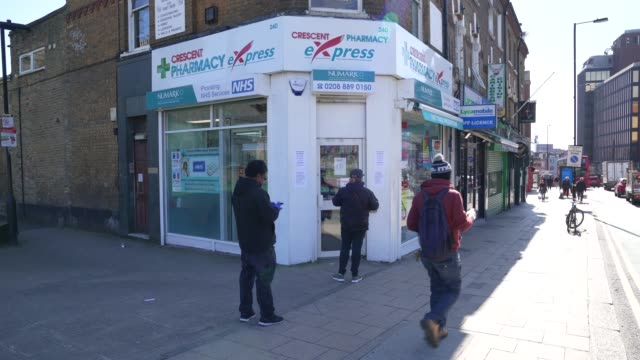 members of the pubic social distance themselves outside a london pharmacy at social distancing the coronavirus pandemic on march 23 2020 in london... - torso stock videos & royalty-free footage
