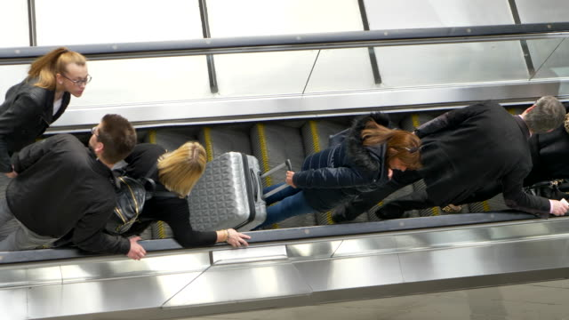 london escalator people hurry top-shot commuters - station stock-videos und b-roll-filmmaterial