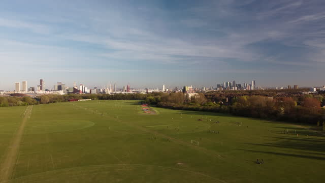 london establisher drone footage of hackney marshes with the city skyline 4 and half miles in the distance - greater london stock videos & royalty-free footage