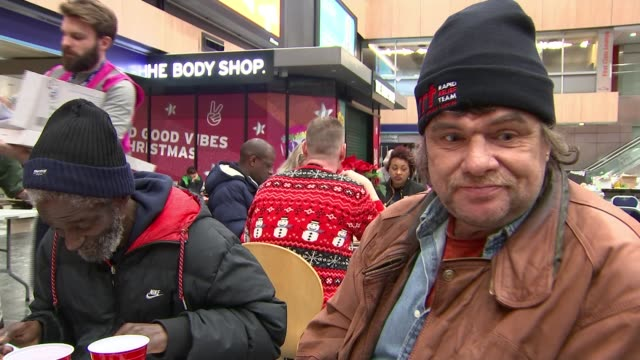 London Euston train station holds festive banquet for around 200 homeless people ENGLAND London Euston Station INT **Music heard intermittently SOT**...