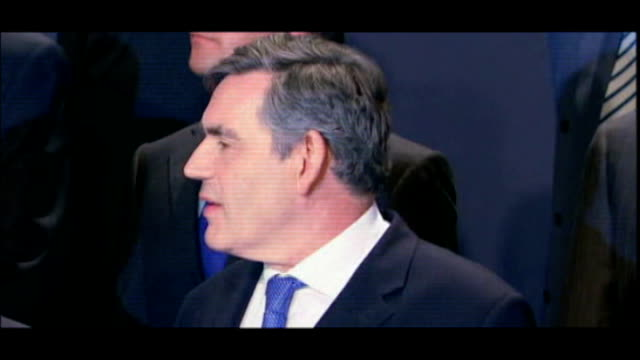 london excel centre photography** gordon brown mp posing for photocall at g20 summit nicholas sarkozy posing for photocall at g20 summit angela... - g20 leaders' summit stock videos & royalty-free footage