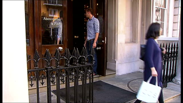 london ext abercrombie fitch sign outside clothing store customers from store and exterior of savile row shop - savile row stock videos and b-roll footage