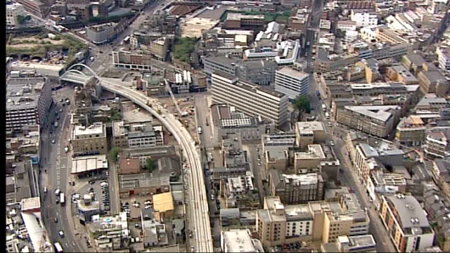 london views / aerials of the new east london overground line which has been revamped and is almost ready for testing crane being moved along train... - イーストロンドン点の映像素材/bロール