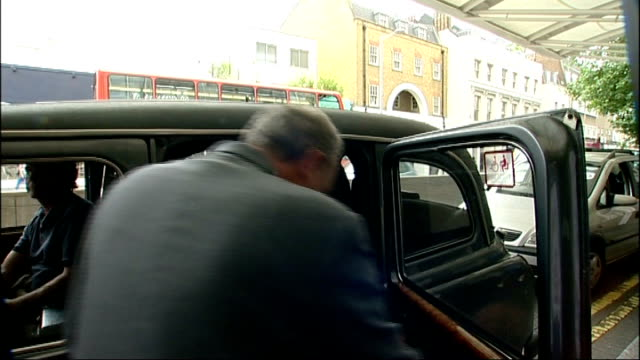 andrew flintoff out from hospital into taxi checking text messages on phone as asked by press what the diagnosis is to which he replies you'll find... - fielder stock videos & royalty-free footage