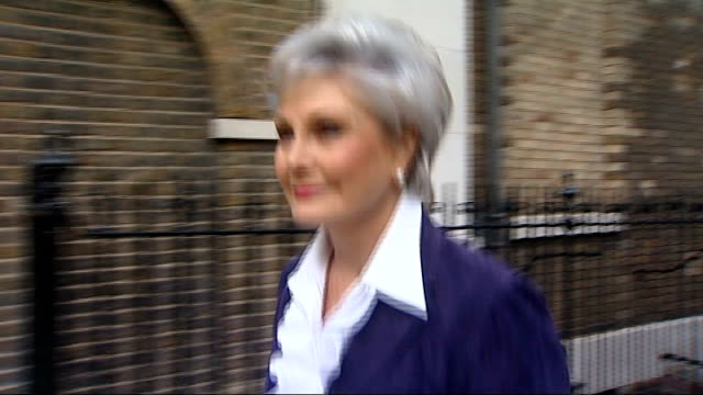 ext angela rippon walking shot and interview sot - angela rippon stock videos & royalty-free footage