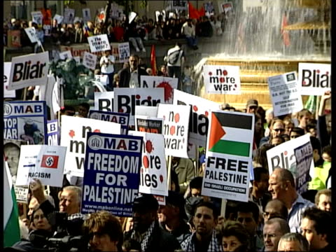london antiwar protestors marching along street with placards during demonstration against british and us involvement in iraq anas altikriti... - minister stock-videos und b-roll-filmmaterial
