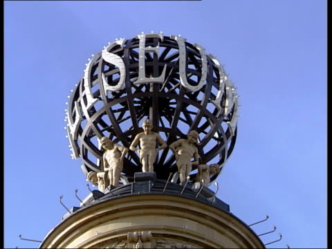 london ext la ball on roof of london coliseum building home of the english national opera with sign 'coliseum' on it int la roof of dome fade to cs... - auditorium stock videos & royalty-free footage