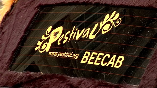 london ext black london cab customised to look like a bee to promote south bank 'pestival' arts event numberplate on cab 'busy' advertisement for... - customised stock videos & royalty-free footage