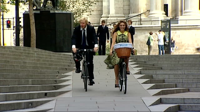 london ext boris johnson cycling towards next kelly brook launch of new cycling campaign 'skyride' - kelly brook stock-videos und b-roll-filmmaterial