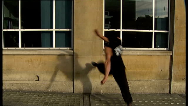 London EXT ***Born Slippy by Underworld overlaid SOT** Good shots of traceurs practicing the art of parkour over London walls and buildings CUTAWAY...