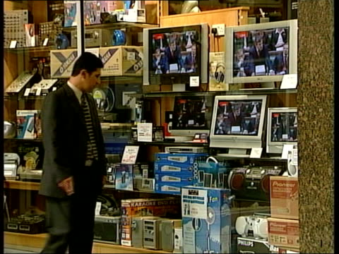london people watching gordon brown speech in house of commons on television screen in shop window la gordon brown mp towards from building with... - house of commons stock videos and b-roll footage