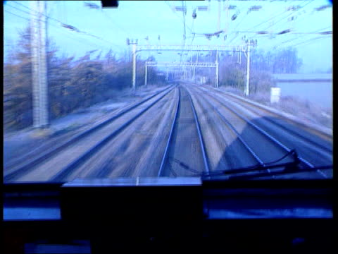 london: ext bv virgin train away out of station int train tgv passengers seated in train as along track along thru countryside tcbv driver at... - fx network stock videos & royalty-free footage