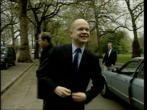 stockvideo's en b-roll-footage met itn england london ext ms conservative leader william hague mp out of car as along towards tory general election campaign advans pan gv advans with... - william hague