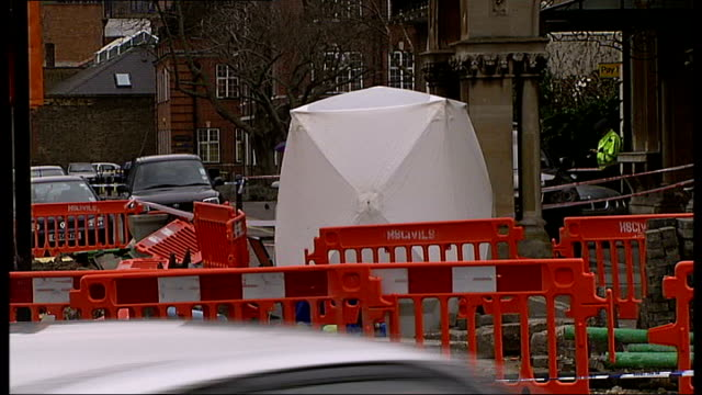 london ext cordonedoff scene next to extensive road works outside chiswick town hall various views of police officers at scene where baby and woman... - town hall stock videos and b-roll footage