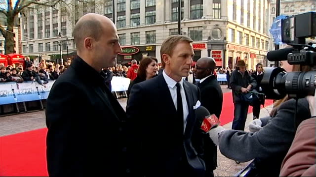 London EXT Daniel Craig talking to press on red carpet at premiere