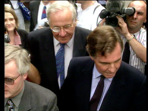 London EXT MS Disgraced former cabinet minister Jonathan Aitken towards surrounded by press GV People looking out of windows CMS Aitken along...