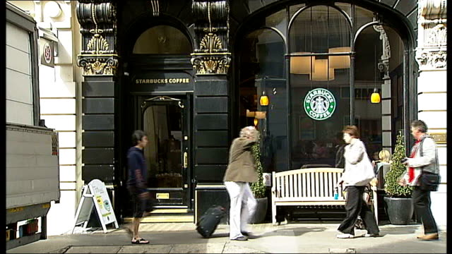 exteriors of starbucks, pret a manger and caffe nero coffee shops woman sitting with hot drink in coffee shop - coffee drink stock videos & royalty-free footage