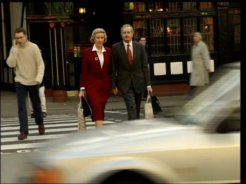 lib england london ext former conservative mp neil hamilton and wife christine crossing road towards and posing for photocall order ref t10080115 - christine last stock-videos und b-roll-filmmaterial